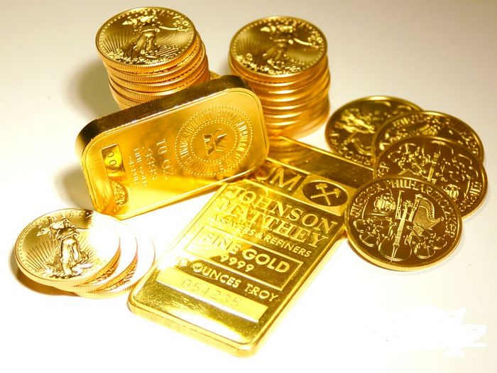 Цена на золото не изменилась из-за падающего доллара сша накануне собрания ецб