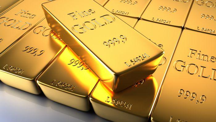 Цена на золото выросла на фоне заключения сделок и падения доллара