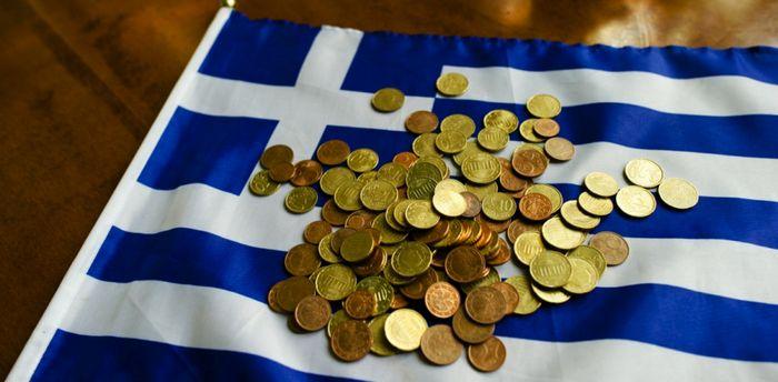 Фьючерсы на золото растут после принятия грецией жестких мер