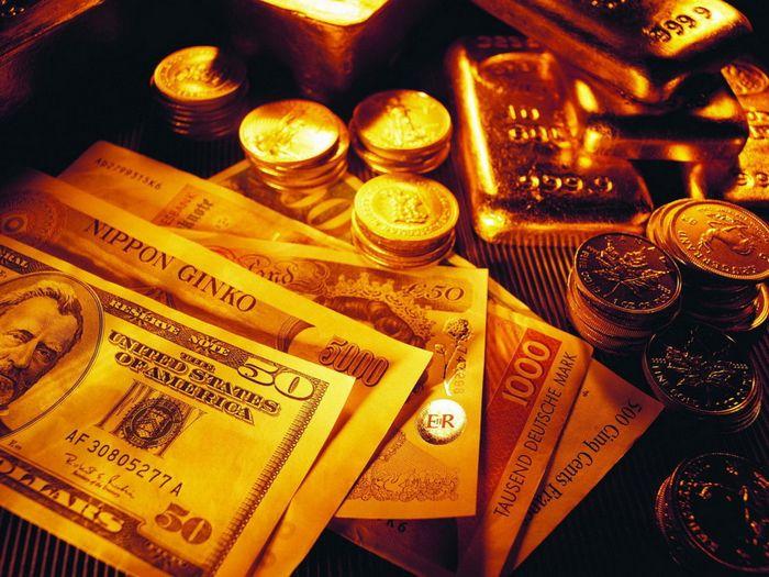 Фьючерсы на золото торгуются около 2-недельного лоу на фоне растущего доллара